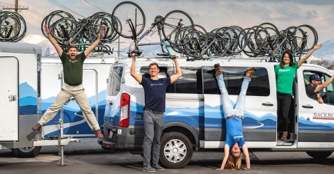 Backroads Leaders in front of vans with bikes