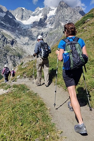 Hikers in Italy on a rugged trail in the mountains